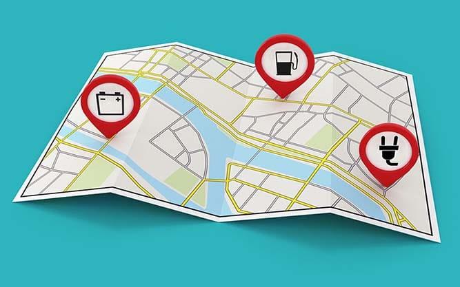 Carte routière avec des points de localisation avec des icones de pompes à essence, batterie et prise de branchement